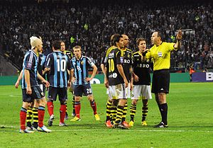 Djurgårdens IF Fotboll league record by opponent - Djurgårdens IF (drak and light blue striped shirts) take on AIK (black shirts) in 2013.