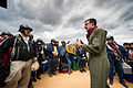 A U.S. Air Force C-130H Hercules aircraft loadmaster, front right, with the Nevada Air National Guard gives a preflight safety briefing to simulated civilian evacuees at the Geronimo landing zone during Joint 140314-F-XL333-032.jpg