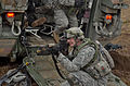 A U.S. Soldier with the 3rd Squadron, 2nd Cavalry Regiment provides security by a Stryker armored vehicle during a mission rehearsal exercise at the Joint Multinational Readiness Center in Hohenfels, Germany 130311-A-UW077-006.jpg