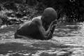 A swimming Rwandan Child.png