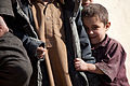 A young boy smiles as Romanian Forces passes through his village, in Zabul province, Afghanistan 120111-A-FZ921-225.jpg
