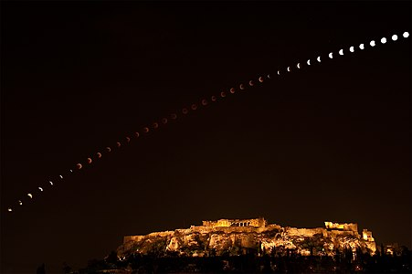 The total phase of the June 15, 2011 lunar eclipse. Its entire duration is covered in this composite of a regular sequence of digital camera exposures, tracking the dark lunar disk as it arced above the Acropolis in Athens, Greece.