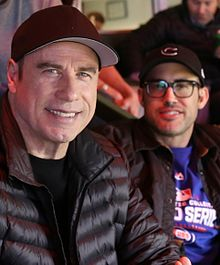 Actors Michael Pena and John Travolta enjoys Game 5 of the 2016 World Series. (30565637262) (cropped).jpg