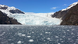 Ice calving - A calving glacier and the resulting ice field.