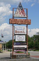 "Faded and rusting sign in parking lot: at top, triangular sign with ""All Star""; below that, very faded ""Bowling""; below that, ""All Star Triangle Bowl""; below that, fresher signs with names of current tenants: Ross Centre, The Word Ministry, The Thrift Store, Everything & Anything, and the phone number 803-534-4550"