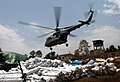 An Indian Air Force (IAF) Mi-17 V5 helicopter returns after relief drop for the next mission at Charikot post recent massive earthquake occurred in Nepal on May 19, 2015.jpg