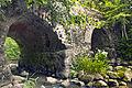 An old abandoned stone bridge over Klūga river at Pumpuri.jpg