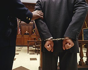 Defendant - Cuffed defendant before criminal court (Transportation Security Administration image)