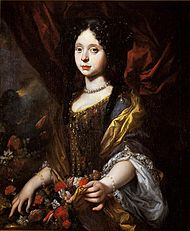 A teenage-girl sports a baroque-style dress enhanced with flowers in the up-folds.