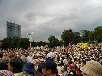 "Protest - Anti-nuclear Power Plant Rally on 19 September 2011 at Meiji Shrine complex in Tokyo. Sixty thousand people marched chanting ""Sayonara nuclear power"" and waving banners, to call on Japan's government to abandon nuclear power, following the Fukushima nuclear disaster."