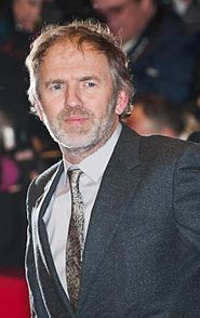 The 62-year old son of father Anton Corbijn and mother Marietje Groeneboer, 176 cm tall Anton Corbijn in 2017 photo