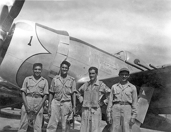 Captain Andrade of Escuadron 201 stands in front of his P-47D with his maintenance team after returning from a combat mission over Luzon. Aztec Eagles P-47D.jpg