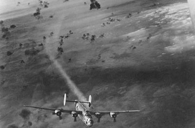 A USAAF B-24 bomber emerges from a cloud of flak with its no. 2 engine smoking. B-24 Flak.jpg