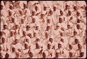 BLACK MUSLIM WOMEN DRESSED IN WHITE APPLAUD EL...