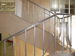 Fall prevention - A staircase with metal handrails