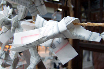 Bad luck omikuji tied to ropes at the Yasaka s...