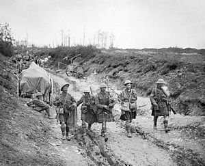 9th (Scottish) Division - A piper of the 7th (Service) Battalion, Seaforth Highlanders leads four men of the 26th Brigade back from the trenches after the attack on Longueval, France, July 1916.