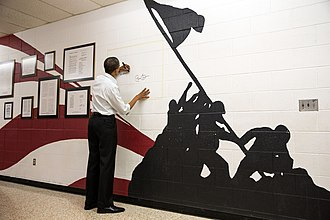 Mentor High School - President Barack Obama signs a memorial wall designed by former art student Anthony Gajary at Mentor High after a campaign event, 2012. The wall was also signed by John McCain in 2008