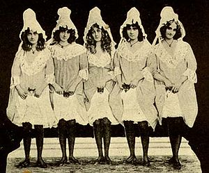 Danish Americans - The Barrison Sisters reveal kittens beneath their skirts, at the conclusion of their notorious vaudeville cat dance, c. 1890s