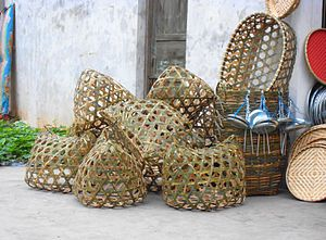 Basket - On the left side are live fowl baskets. Directly to the right are flat baskets used for selling shrimp and small fish in Haikou City, Hainan Province, People's Republic of China