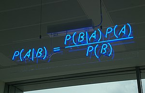Bayes' theorem - A blue neon sign, showing the simple statement of Bayes' theorem