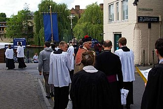 Beating the bounds - Beating the Bounds in Mill Lane, Cambridge. The clergy and people of Little St Mary's Church annually walk round the boundaries of the parish, singing hymns and psalms and praying for blessings on the residents and their activities.