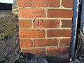 Benchmark in Brick Wall - geograph.org.uk - 666717.jpg