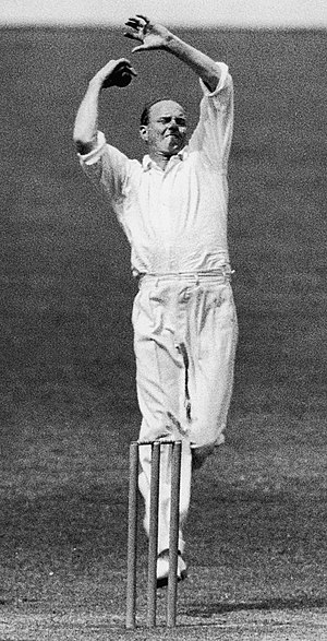 Bill O'Reilly (cricketer) - O'Reilly in mid-action, showing his unusual whirling arms