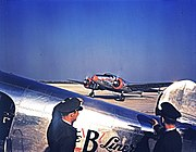 Braniff Airline Pilots Watching a Lockheed 12A Electra Junior