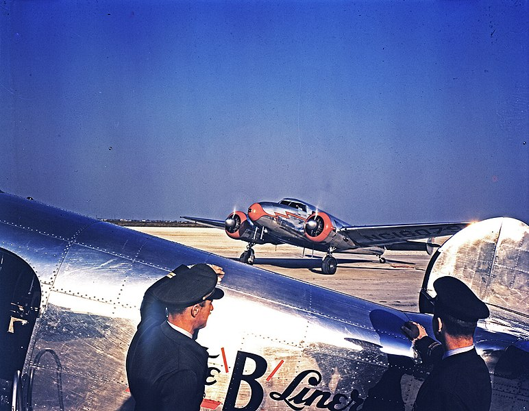File:Braniff Airline Pilots Watching a Lockheed 12A Electra Junior.jpg