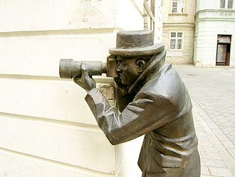 Paparazzi - Statue of a paparazzo by sculptor Radko Macuha in Bratislava, Slovakia