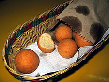Fried balls of dough in a basket.