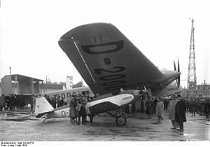 Junkers A50 - A50ce D-1842 shelters under the wing of big sister G.38 D-2000 in May 1930