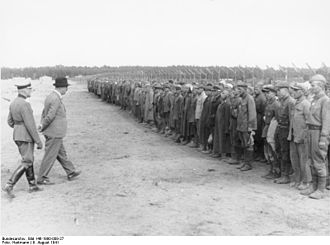 Stalag II-B - A delegation of the International Red Cross led by Prof. Carl Jacob Burckhardt inspect POWs at Stalag II-B, 9 August 1941