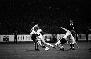 Jürgen Klinsmann - Klinsmann (centre) playing for VfB Stuttgart against Dynamo Dresden in the semi-final of the 1988–89 UEFA Cup.