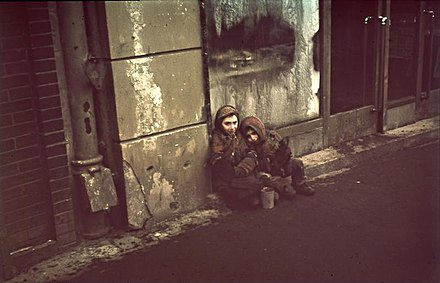 Starving Jewish children in the Warsaw Ghetto (1940-1943), during the German occupation of Poland Bundesarchiv N 1576 Bild-003, Warschau, Bettelnde Kinder.jpg
