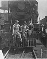 Busch (Bush) Terminal. Women Laborers Seated on Front of Engine in Railroad Yard (3904009156).jpg