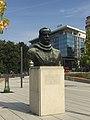 Bust of Dimitrije Tucović at Slavija Square (Hilton in background), September 2020.jpg