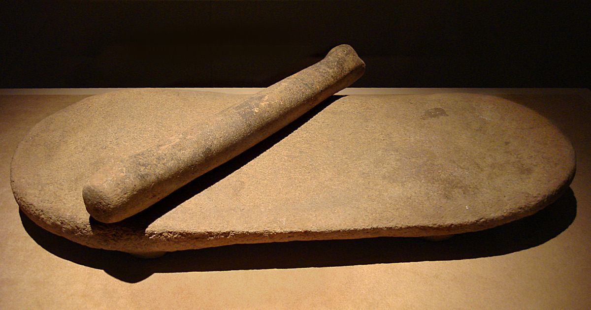 CMOC Treasures of Ancient China exhibit - millstone and roller.jpg
