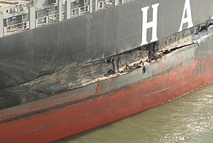Cosco Busan oil spill - The damaged MV ''Cosco Busan'' after striking the bridge tower fender