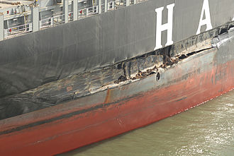 Cosco Busan oil spill - The damaged MV Cosco Busan after striking the bridge tower fender