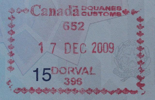 Canadian visa stamp By Kristoferb (Own work) [CC BY-SA 3.0 (http://creativecommons.org/licenses/by-sa/3.0)], via Wikimedia Commons