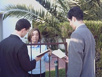 New religious movement - Jehovah's Witnesses evangelising from house to house