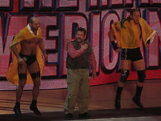 Dutch Mantel - Mantel (center) with The Real Americans, Antonio Cesaro (left) and Jack Swagger