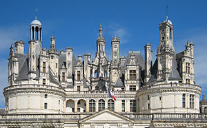 Château de Chambord - The elaborately developed roof line. It should be noted that the keep's façade is asymmetrical, with the exception of the Northwest façade, latterly revised, when the two wings were added to the château.