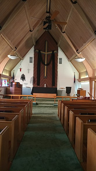 The chancel of this Lutheran church features a very large altar cross. Chancel of Grace Lutheran Church on Good Friday.jpg