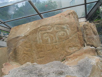 Prehistoric Hong Kong - Rock carving on Cheung Chau, 3000-year-old rock carving discovered in 1970 east of the island below Warwick Hotel. It consists of two groups of similar carved lines surrounding small depressions