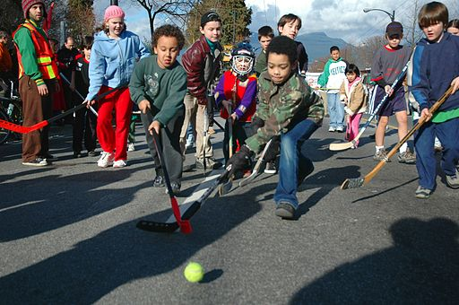 Children playing road hockey in Vancouver