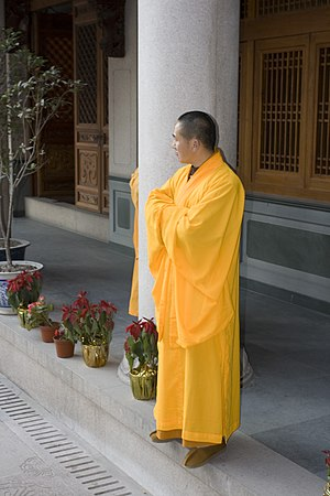 English: Chinese Buddhist monk with a long yel...