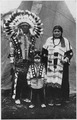 Circus Sarrasani - Three Sioux Indians in native dress in front of teepee - NARA - 285598.tif